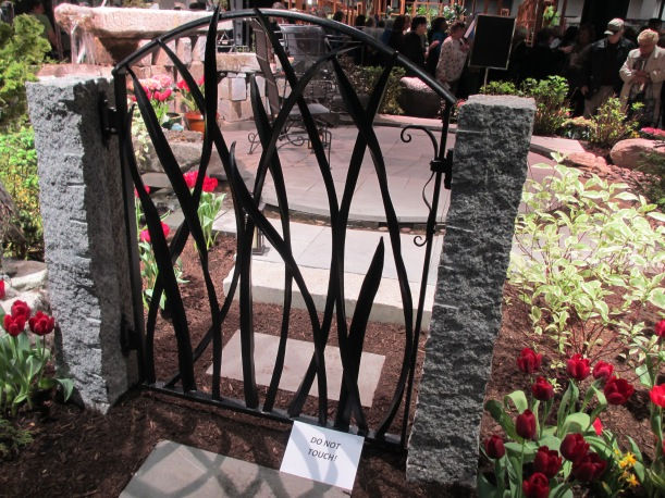 Gate posing as sculpture in the garden.